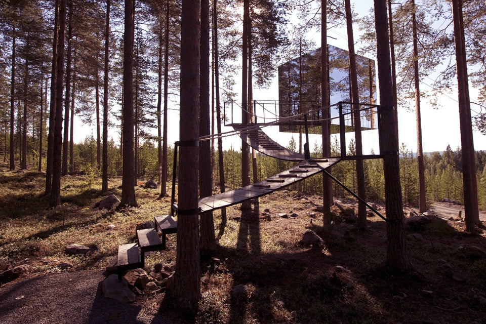 treehotels mirrorcube may be as closest thing to invisible as you can get without wizardry the exterior mirrored walls mimic the surrounding forest with
