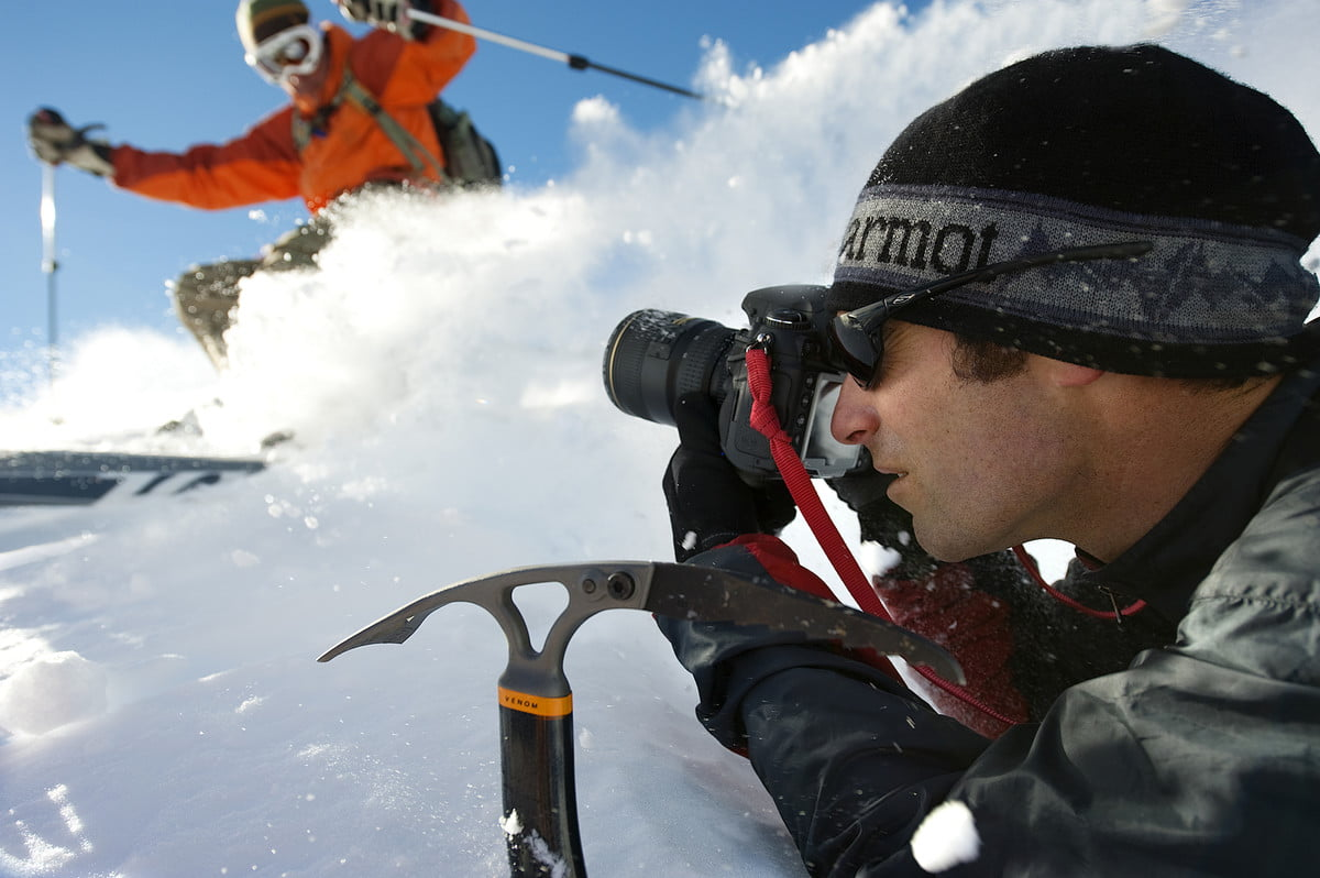 to get perfect mountain shot corey rich climbs mountains a photographer photographs skier