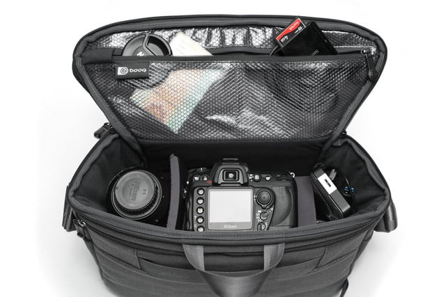 squeeze 2 dslrs and laptop into booqs python catch bag theres still room booq 7