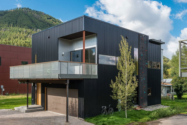 jackson hole area home features exterior rock climbing wall cache creek residence carney logan burke architects 004