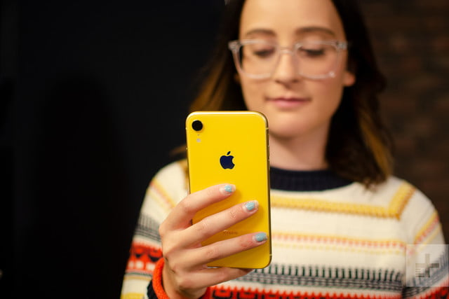 revision apple iphone xr review holding